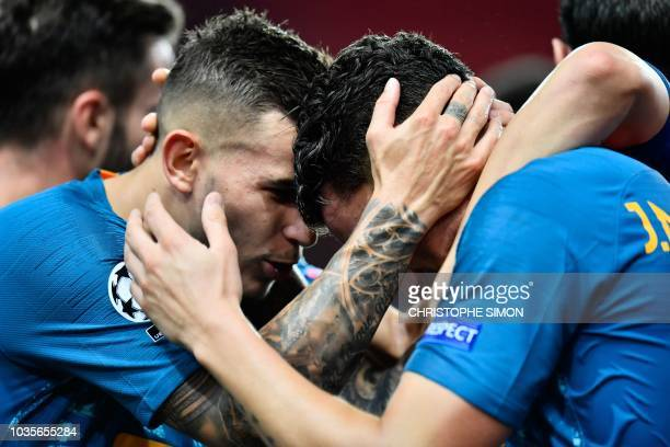 Atletico Madrid's Uruguayan defender Jose Gimenez celebrates with teammates after scoring a goal during the UEFA Champions League first round...