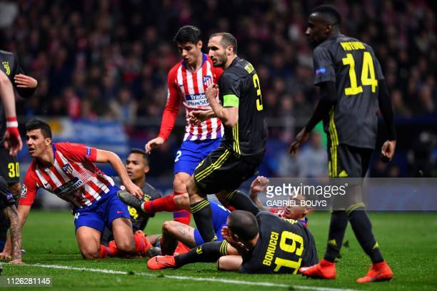 Atletico Madrid's Uruguayan defender Jose Gimenez scores a goal during the UEFA Champions League round of 16 first leg football match between Club...