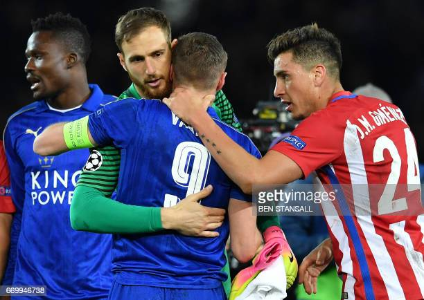 Atletico Madrid's Uruguayan defender Jose Maria Gimenez and Atletico Madrid's Slovenian goalkeeper Jan Oblak console Leicester City's English striker...