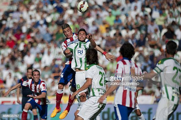 Atletico Madrid's Uruguayan defender Jose Maria Gimenez vies with Cordoba's Romanian forward Florin Andone during during the Spanish league football...