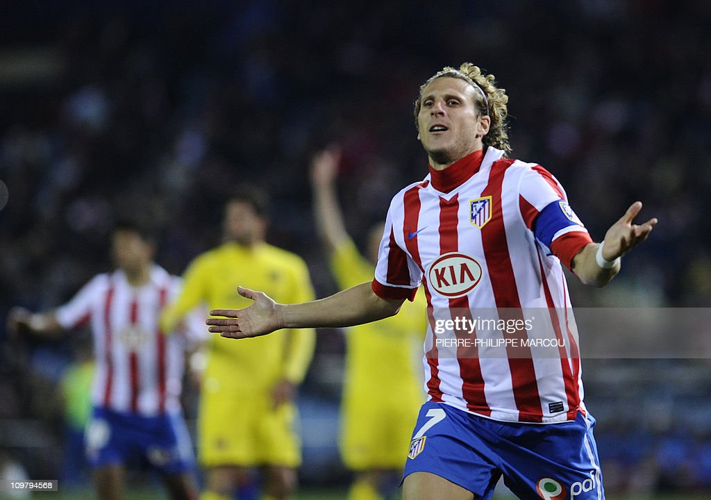 Atletico Madrid's Uruguayan forward Diego Forlan gestures during their Spanish league football match Atletico de Madrid vs Villarreal on March 5, 2011 at the Vicente Calderon stadium in Madrid.