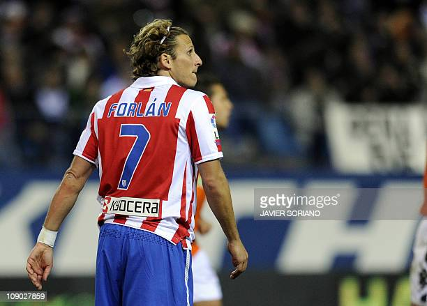 Atletico Madrid's Uruguayan forward Diego Forlan reacts after missing a penalty during a Spanish League football match Atletico de Madrid vs Valencia...