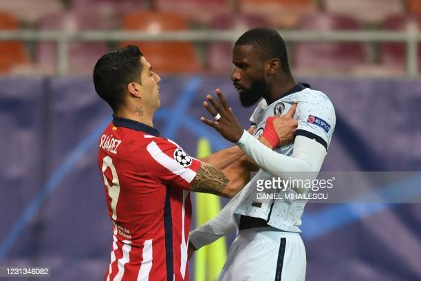 Atletico Madrid's Uruguayan forward Luis Suarez and Chelsea's German defender Antonio Rudiger argue during the UEFA Champions League round of 16...