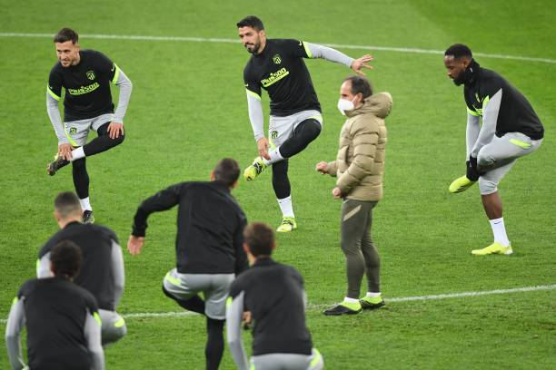 Atletico Madrid's Uruguayan forward Luis Suarez and teammates attend a training session on the eve of the UEFA Champions League round of 16 first leg...