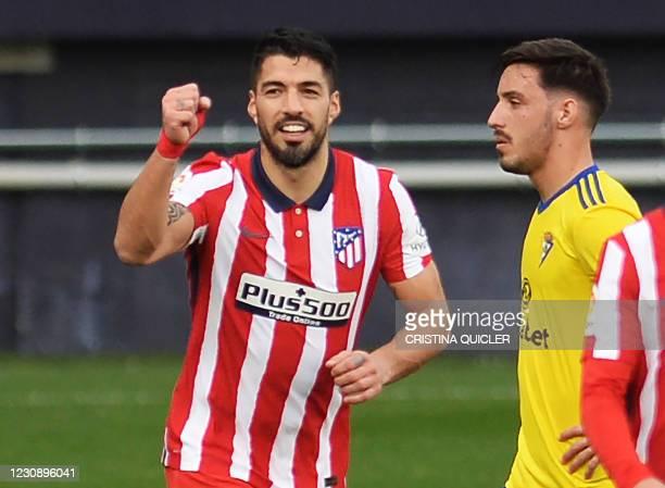 Atletico Madrid's Uruguayan forward Luis Suarez celebrates after scoring a goal during the Spanish league football match Cadiz CF against Club...