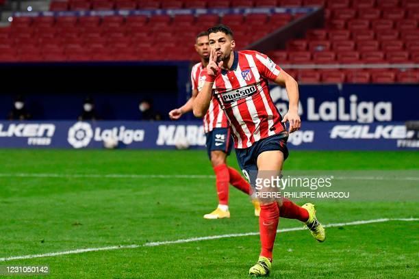 Atletico Madrid's Uruguayan forward Luis Suarez celebrates after scoring a goal during the Spanish league football match between Club Atletico de...