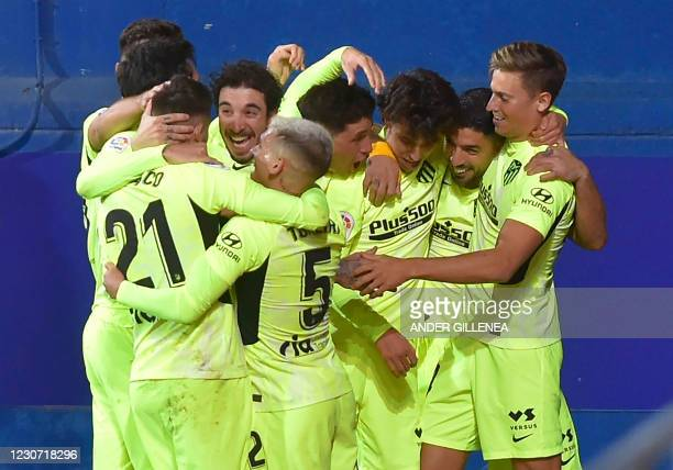 Atletico Madrid's Uruguayan forward Luis Suarez celebrates with teammates after scoring during the Spanish league football match SD Eibar against...