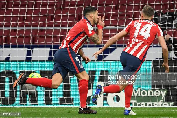 Atletico Madrid's Uruguayan forward Luis Suarez celebrates with Atletico Madrid's Spanish midfielder Marcos Llorente after scoring a goal during the...