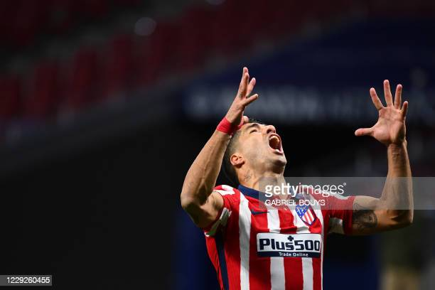 Atletico Madrid's Uruguayan forward Luis Suarez reacts shouting after missing a goal opportunity during the Spanish League football match between...