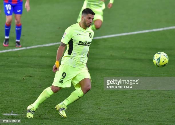 Atletico Madrid's Uruguayan forward Luis Suarez scores during the Spanish league football match SD Eibar against Club Atletico de Madrid at the...