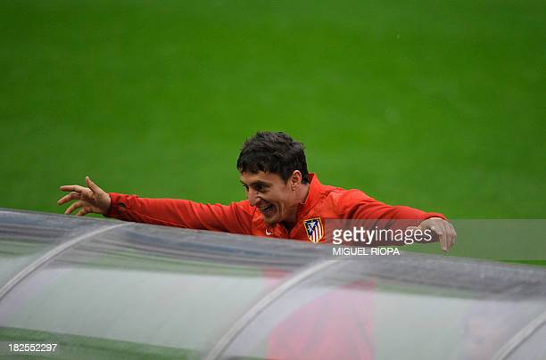 Atletico Madrid's Uruguayan midfielder Cristian Rodriguez jokes before a training session at the Dragao stadium in Porto on September 30 2013 on the...