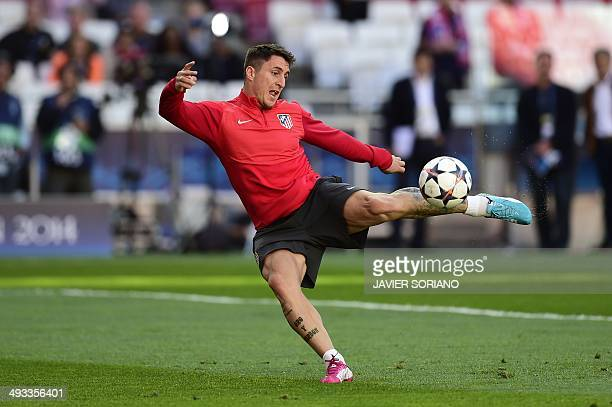 Atletico Madrid's Uruguayan midfielder Cristian Rodriguez takes part in a training session of Atletico Madrid on the eve of the UEFA Champions League...