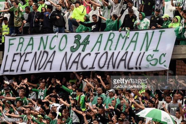 Atletico Nacional fans cheer during the farewell to Argentinian goalkeeper Franco Armani who leaves the club at the Atanasio Girardot Stadium in...