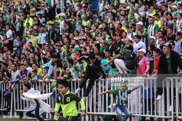 Atletico Nacional fans invade the field during the farewell to Argentinian goalkeeper Franco Armani who leaves the club at the Atanasio Girardot...