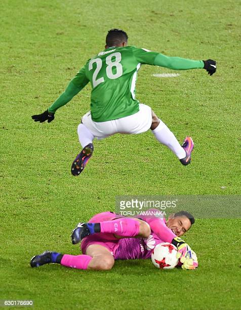 Atletico Nacional forward Orlando Berrio jumps over Club America goalkeeper Moises Munoz during the Club World Cup thirdplace playoff football match...