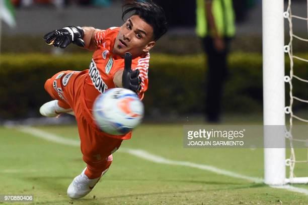 Atletico Nacional goalie Fernando Monetti dives for the ball during their Colombian League second leg final match against Deportivo Cali at Atanasio...