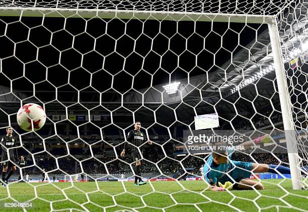 Atletico Nacional goalkeeper Franco Armani attempts to stop a goal by Kashima Antlers forward Yuma Suzuki during the Club World Cup football...