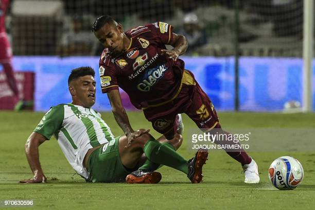 Atletico Nacional player Diego Braghieri vies for the ball with Deportes Tolima player Sebastian Villa during their Colombian League final game at...