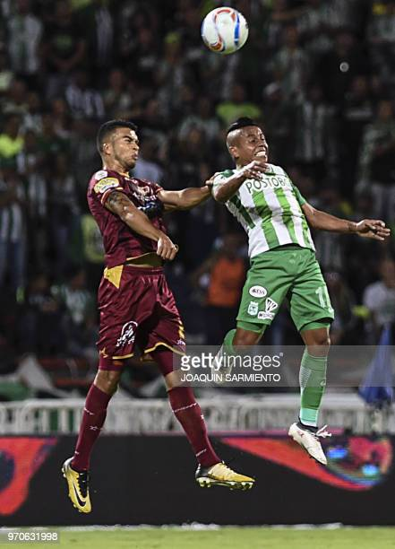 Atletico Nacional player Vladimir Hernandez vies for the ball with Deportes Tolima player Juan Guillermo Arboleda during their Colombian League final...