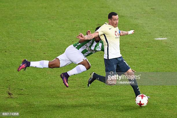 Atletico Nacional's defender Farid Diaz fights for the ball with Club America's midfielder Rubens Sambueza during the Club World Cup thirdplace...