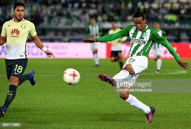 Atletico Nacional's forward Jhon Mosquera shoots the ball past Club America's defender Bruno Valdez during the Club World Cup thirdplace playoff...