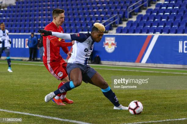 Atletico Pantoja defender Guillermo Ferreras battles New York Red Bulls midfielder Alex Muyl during the first half of the CONCACAF Champions League...