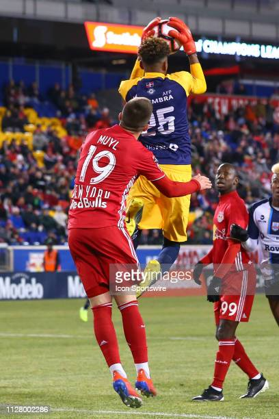 Atletico Pantoja goalkeeper Pascual Ramirez goes up in front of New York Red Bulls midfielder Alex Muyl during the first half of the CONCACAF...