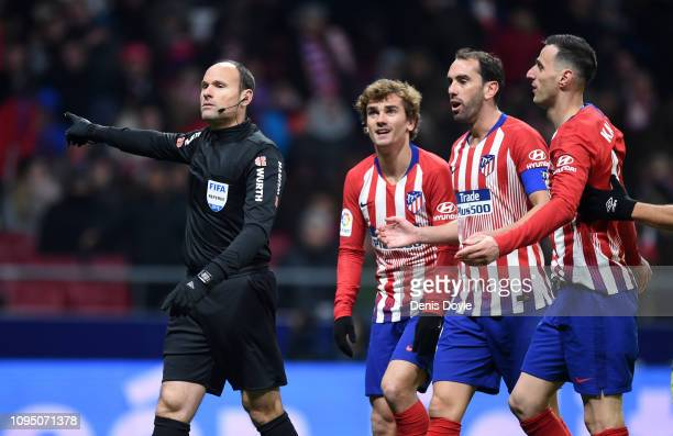 Atletico players appeal to the referee Antonio Mateu Lahoz be he gives the penalty during the Copa del Rey Round of 16 match between Atletico Madrid...