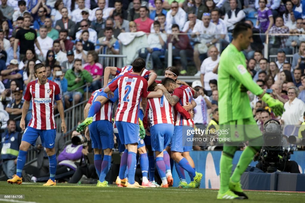 Atletico players celebrate a goal during the Spanish league football match Real Madrid CF vs Club Atletico de Madrid at the Santiago Bernabeu stadium in Madrid on April, 8, 2017. /