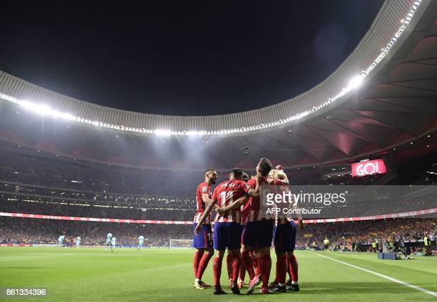 Atletico players celebrate a goal during the Spanish league football match Club Atletico de Madrid vs FC Barcelona at the Wanda Metropolitano stadium...