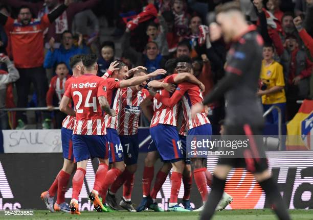 TOPSHOT Atletico players celebrate the opening goal during the UEFA Europa League semifinal second leg football match between Club Atletico de Madrid...
