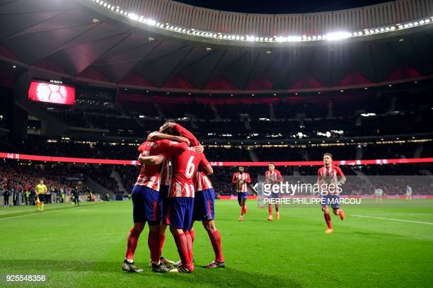 Atletico players celebrate their opening goal during the Spanish league football match Club Atletico de Madrid against Club Deportivo Leganes SAD at...