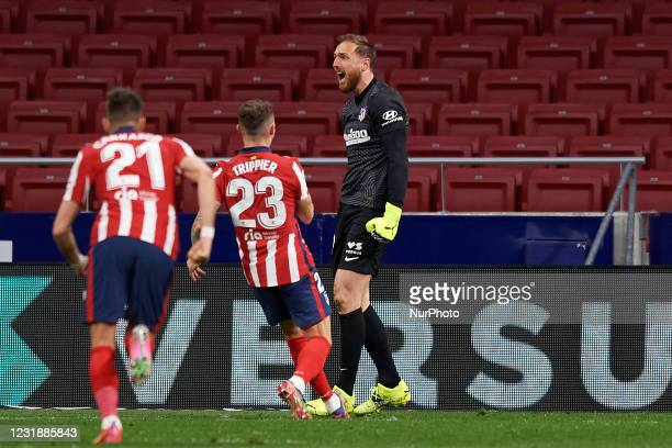 Atletico players congratulate goalkeeper Jan Oblak for stopping the penalty during the La Liga Santander match between Atletico de Madrid and...