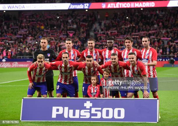 Atletico players pose before the Spanish league football match Atletico Madrid vs Real Madrid at the Wanda Metropolitan stadium in Madrid on November...