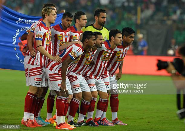 AtleticodeKolkata team members pose for a photograph before the start of the Indian Super League football match against Chennaiyin FC in Chennai on...