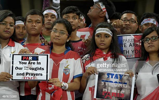 AtleticodeKolkata's fans hold posters to condemn the Paris attacks prior to the Indian Super League football match between AtleticodeKolkata and...