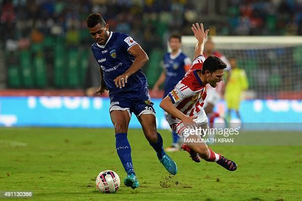 AtleticodeKolkata's Helder Manuel Marques Postiga falls while Chennaiyin forward Jayesh Rane takes the ball during the Indian Super League football...