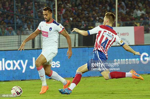 AtleticodeKolkata's Jose Luis Arroyo vies with Delhi Dynamo FC's forward Robin Singh during the Indian Super League football match between and...