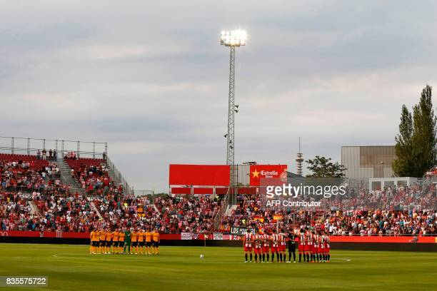 Atletico's and Girona's players observe a minute's silence for the victims of Barcelona's attack before the Spanish league football match Girona FC...