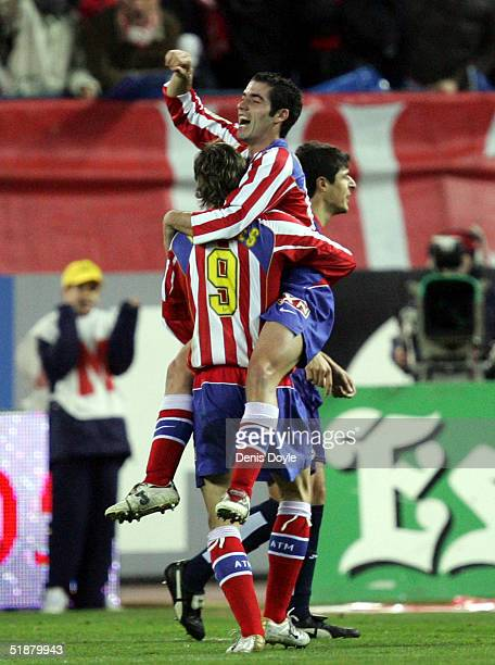 Atleticos Antonio Lopez celebrates with captain Fernando Torres after scoring a goal against Deportivo during an Atletico Madrid v Deportivo La...