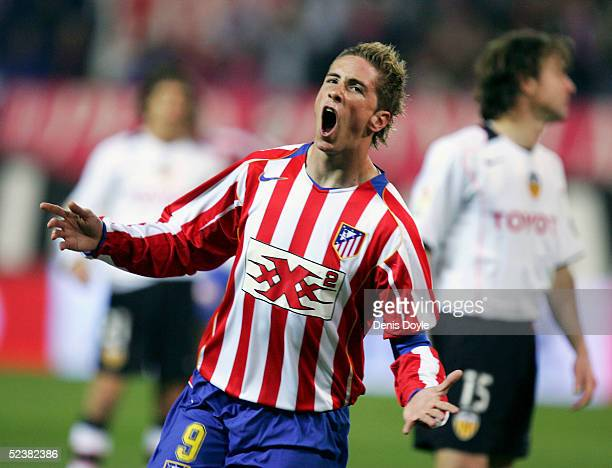 Atleticos captain Fernando Torres celebrates after scoring a goal during a Primera Liga soccer match between Atletico Madrid and Valencia at the...