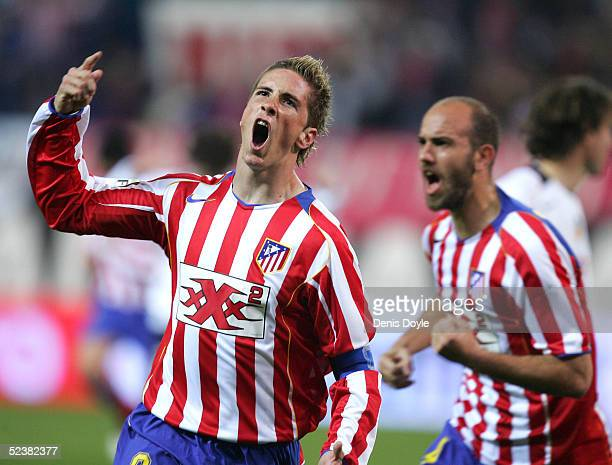 Atletico's captain Fernando Torres celebrates after scoring a goal during the Primera Liga match between Atletico Madrid and Valencia on March 13...