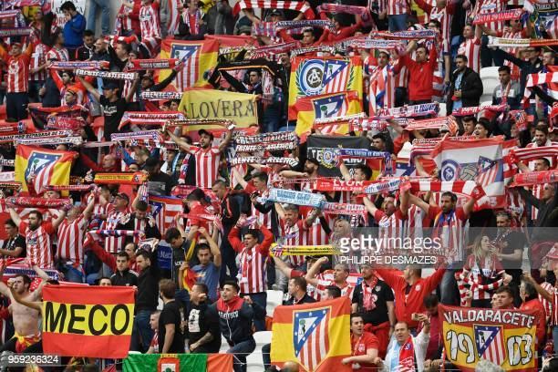 TOPSHOT Atletico's fans brandish scarfs before the UEFA Europa League final football match between Olympique de Marseille and Club Atletico de Madrid...