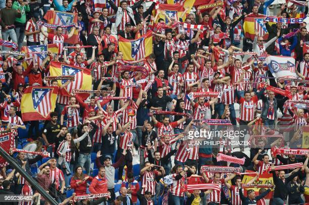 Atletico's fans brandish scarfs before the UEFA Europa League final football match between Olympique de Marseille and Club Atletico de Madrid at the...