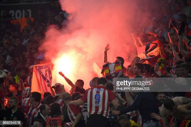 Atletico's fans light flares during the UEFA Europa League final football match between Olympique de Marseille and Club Atletico de Madrid at the...