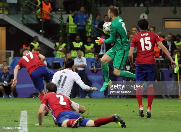Atletico's goalkeeper Jan Oblak Saul Niguez Stefan Savic vie for the ball with Real's Gareth Bale during the UEFA Champions League Final between Real...