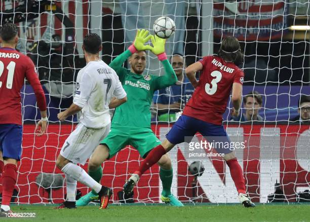 Atletico's goalkeeper Jan Oblak saves the ball next to Real's Cristiano Ronaldo and Atletico's Filipe Luis during the UEFA Champions League Final...