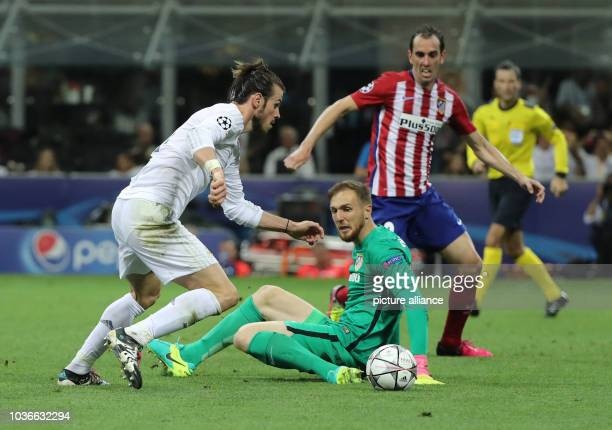 Atletico's goalkeeper Jan Oblak vies for the ball with Real's Gareth Bale during the UEFA Champions League Final between Real Madrid and Atletico...