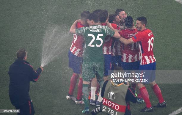 TOPSHOT Atletico's players celebrate their victory after winning the UEFA Europa League final football match between Olympique de Marseille and Club...