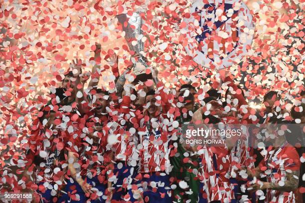 Atletico's players celebrate with the trophy after the UEFA Europa League final football match between Olympique de Marseille and Club Atletico de...